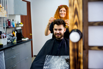 Stylist finishes haircut