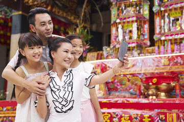 Family taking a selfie in a temple
