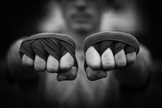 Beautiful black and white image of male fists in boxing taping