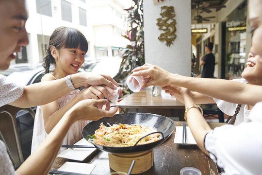 Family celebrating Chinese New year with Yu Sheng
