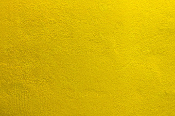 The yellow cement concrete texture wall background