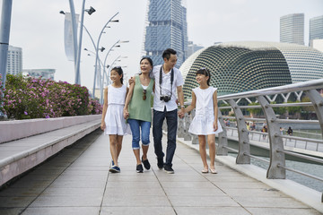 Family of four chilling at the Esplanade Bridge, Singapore