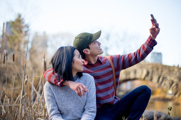 Asian tourists taking selfies in Central Park