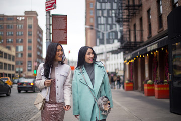 Two girlfriends walking on the streets of meat packing District