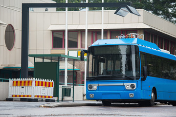 Electric bus at a stop is charged by induction charging
