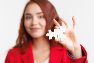 Problem solution concept flat.Man's hand places last detail of puzzle in jigsaw. Concept: diversity, team work and access solution.