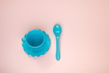 blue toy tea set on a pink background