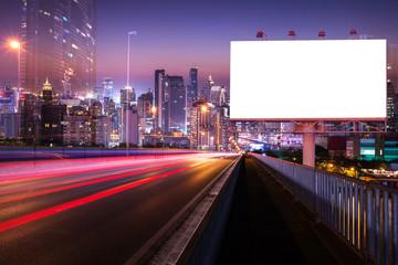 light trail night street with blank white billboard