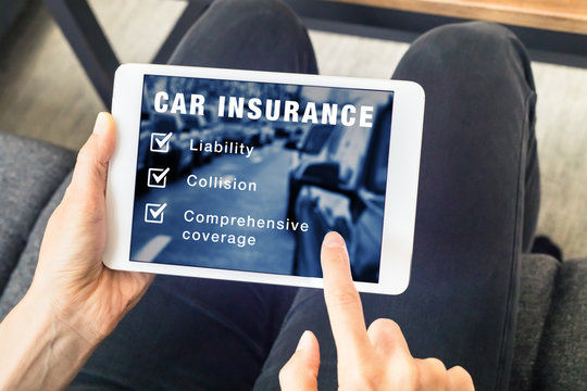 Person choosing car insurance coverage options on tablet computer screen