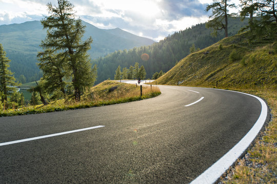 Asphalt road in Austria, Alps in a summer day.