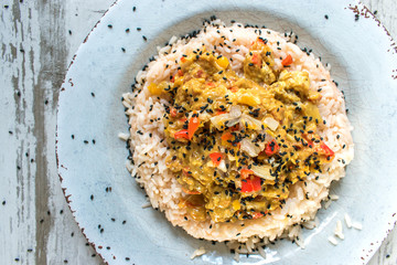 Spicy curry chicken on rice with black sesame seeds