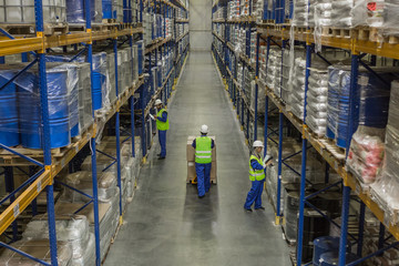 Male workers doing their business in warehouse