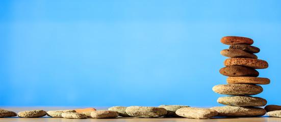 Zen stones stack on blue background