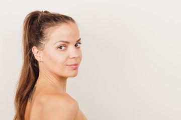 Beautiful naked girl with long dark hair