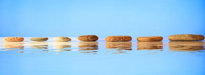 Zen stones row on blue background
