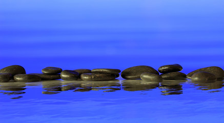 Zen stones row on blue background
