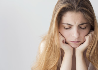 Portrait of sad depressed young woman