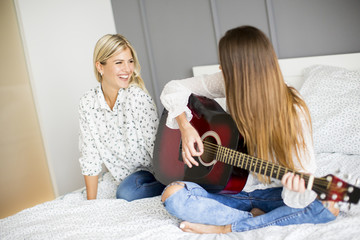 Two young women with acoustic guitar