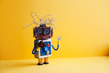 Fototapeta Creative design crazy robot toy, electric wires hairstyle, big eye glasses, electronic circuit blue silver body, red heart. yellow background. copy space obraz