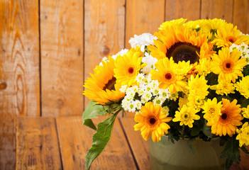 Autumn Flower Boquet with Sun Flowers on Wooden Background