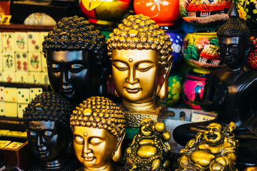 Black and gold Buddha statues souvenirs at the local market in Ho Chi Minh city (Saigon), Vietnam