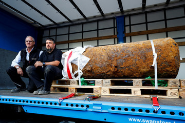 Bomb disposal expert Rene Bennert and Dieter Schweizler speak next to defused massive World War Two bomb after tens of thousands of people evacuated their homes in Frankfurt