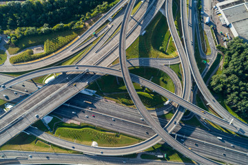 Complex junction and cars traffic. Aerial vertical shot.