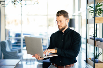 Young business man executive using laptop in office