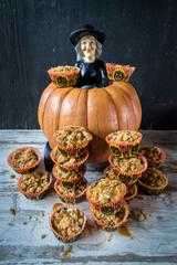 Halloween pumpkin witch delivers pumpkin seed muffins
