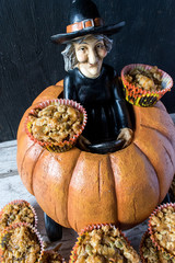 Halloween pumpkin witch delivers pumpkin seed muffins