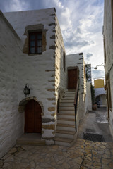 Old traditional buildings in Skala village on Patmos island in Greece.