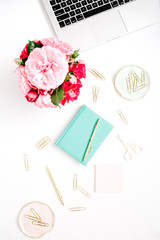 Flat lay home office desk. Female workspace with laptop, pink and red roses bouquet, golden accessories, mint diary on white background. Top view feminine background.