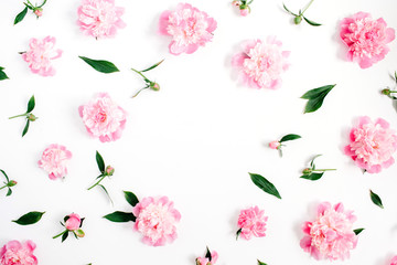 Frame of pink peony flowers, branches, leaves and petals with space for text on white background. Flat lay, top view. Peony flower texture.