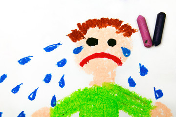 Photo of colorful drawing: Sad crying little boy  on white paper background