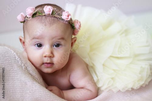 Beb con tut y diadema de flores Stock photo and royaltyfree