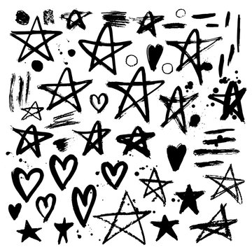 Set of hand drawn stars and hearts. Grunge elements. Brush strok