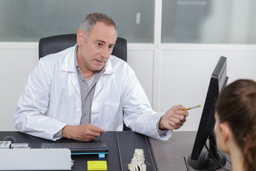 doctor presenting results on computer