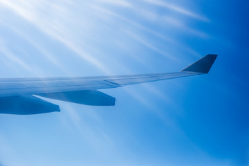 Wing aircraft against the sky in the sunlight