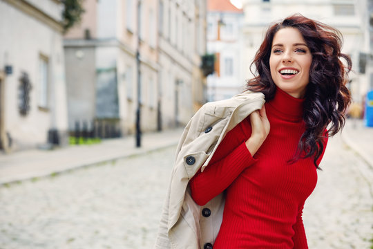 Beautiful woman in autumn style in town. Fashionable concept