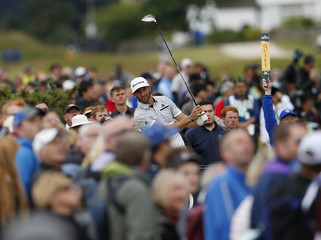Johnson of the U.S.watches his tee shot on the fourth hole during the final round of the British Open golf championship on the Old Course in St. Andrews, Scotland