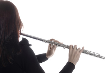 Flute music. Flutist hands flute instrument