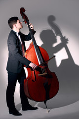 Printed kitchen splashbacks Music Double bass player playing contrabass Jazz musician