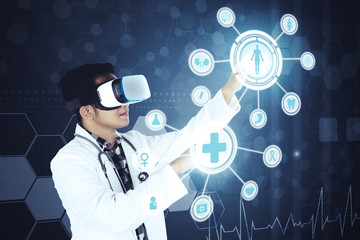 Asian doctor working with futuristic screen