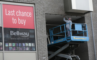 A man works at a Bellway housing development in London
