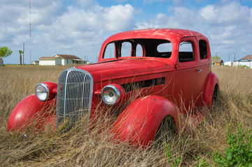 Old Red Car in the Field