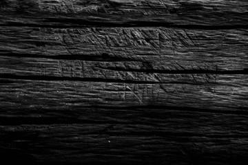 Black wooden texture background.