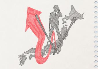 ノートに描いた日本から飛び出すビジネスマンのシルエット