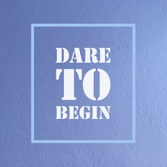 "Inspirational motivational quote ""Dare to begin"" on purple wall background."