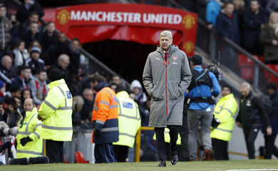 Arsenal manager Arsene Wenger walks out before the start of the second half