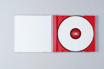 Blank CD on gray background. Mockup for branding